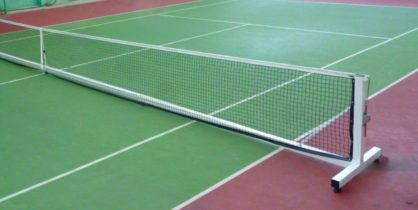 Portable TNMES tennis system on a green court