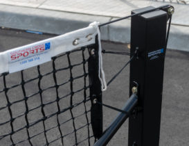 Oblique angle of tennis net tensioning system