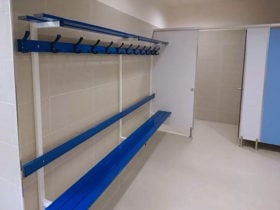 Locker room shelves against beige wall