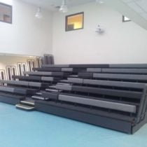 Upholstered bench seating with varying shades of grey